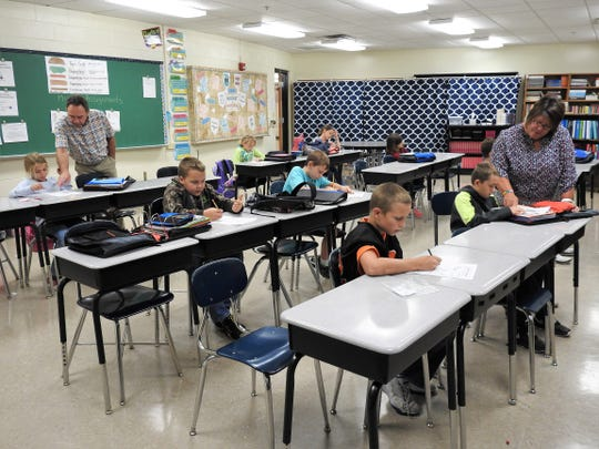 Teachers at Ridgewood Middle School help students with their homework during an after-school program funded by the 21st Century Community Learning Centers Grant.