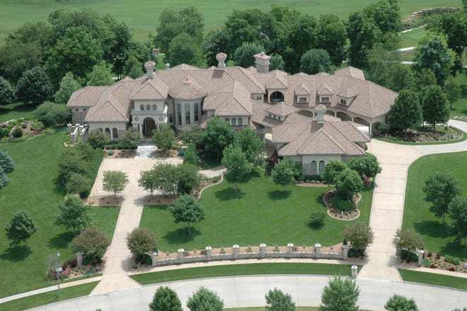 Billionaire Dennis Albaugh has sold his massive 10,000-square-foot Ankeny home to Todd Rueter, an Elkhart businessman, for $2.32 million.