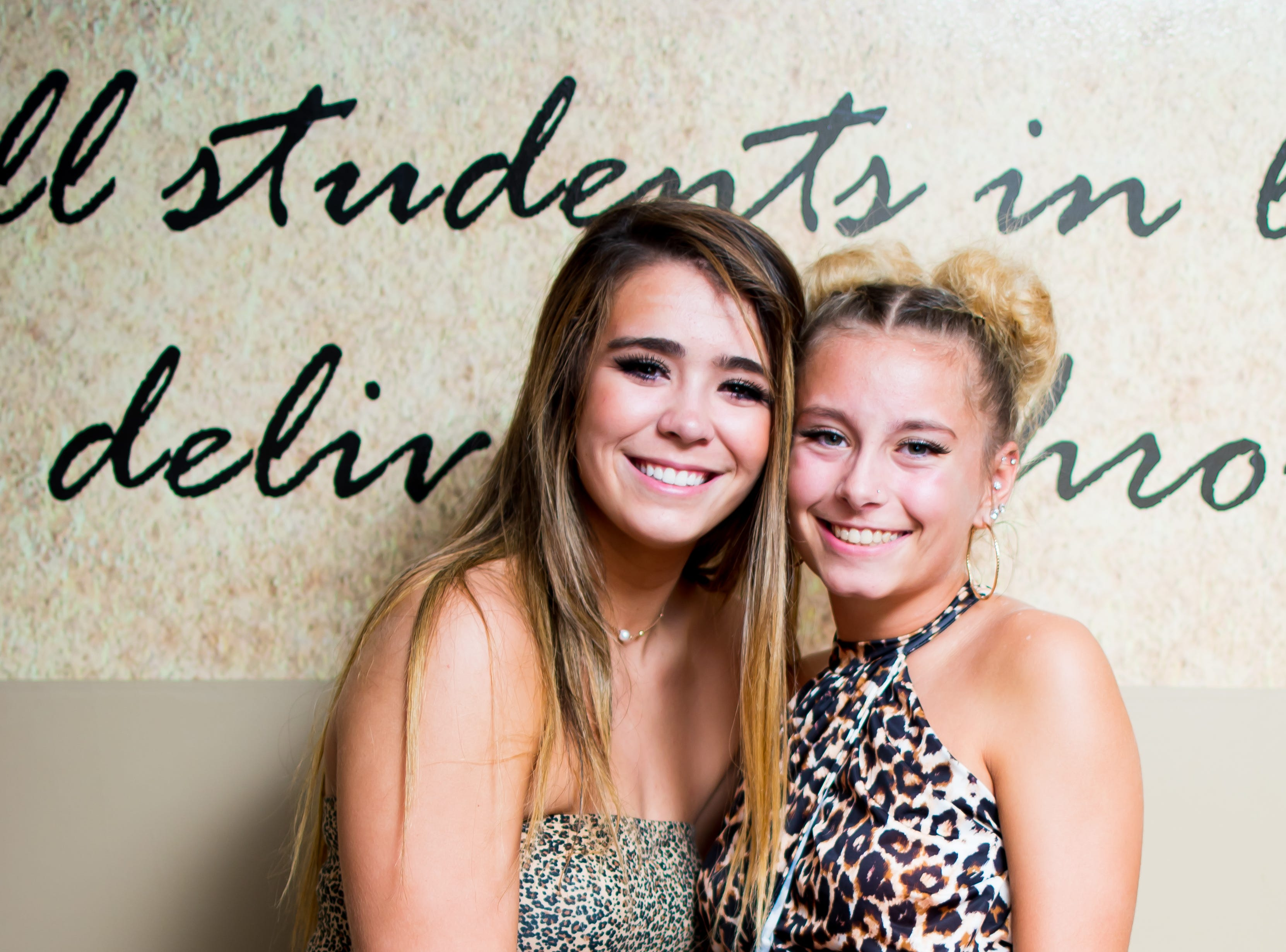 Sophia Harris, 17, and Alecia Hammond, 17, dress up for Southeast Polk High's homecoming dance on Saturday, September 22, 2018 in Southeast Polk High.