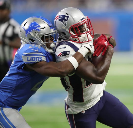 Lions cornerback Nevin Lawson tackles Patriots running back Sony Michel.