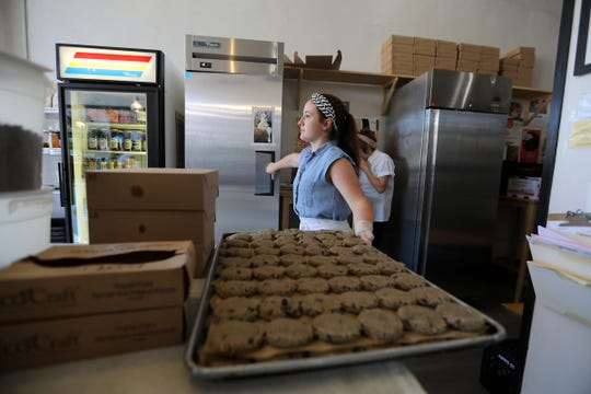 Casey Kempton, 24, of Detroit places prepped pastries in the refrigerator at Sister Pie bakery.
