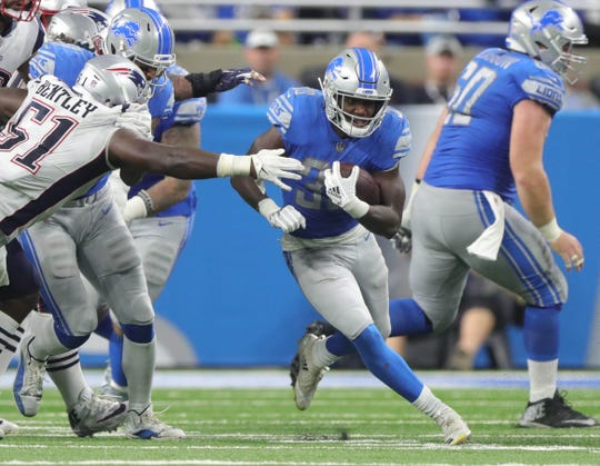 Rookie Kerryon Johnson runs the ball against the Patriots during the second half Sept. 23 at Ford Field.