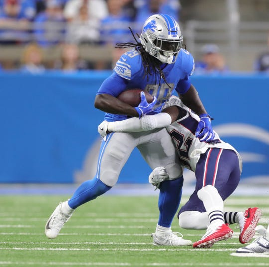 Detroit Lions running back LeGarrette Blount is tackled by the New England Patriots linebacker Elandon Roberts during the first quarter Sunday, Sept. 23, 2018 at Ford Field.