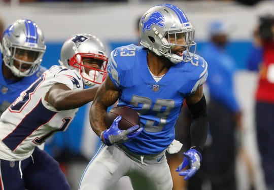 Darius Slay intercepts a pass intended for Patriots receiver Phillip Dorsett during the second half.