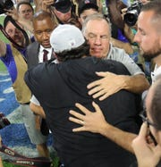 Matt Patricia and Bill Belichick embrace after the Lions' win this season.