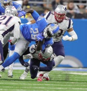Detroit Lions running back LeGarrette Blount runs the ball against the New England Patriots during the first quarter Sunday, Sept. 23, 2018 at Ford Field.