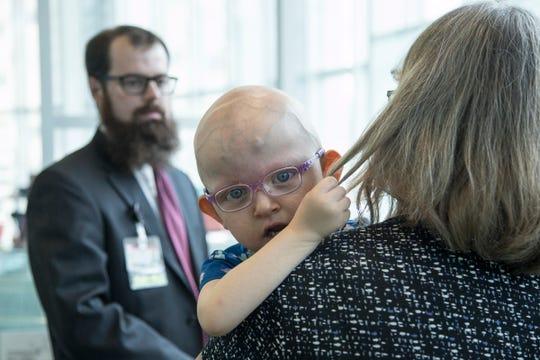 Marlene Berthoud, 3, of Mattawan, looks away as her grandmother Sue Lockhart of Gobles, talks to Dr. Caleb Bupp at Helen DeVos Children's Hospital in Grand Rapids, Wednesday, September 19, 2018.