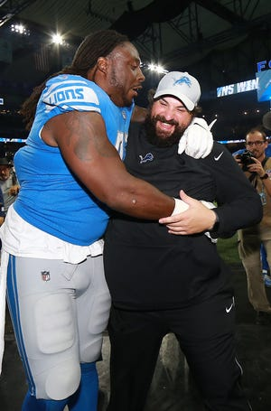 Detroit Lions head coach Matt Patricia celebrates with Ricky Jean Francois after the Lions defeated the Patriots, 26-10, at Ford Field on Sept. 23, 2018.