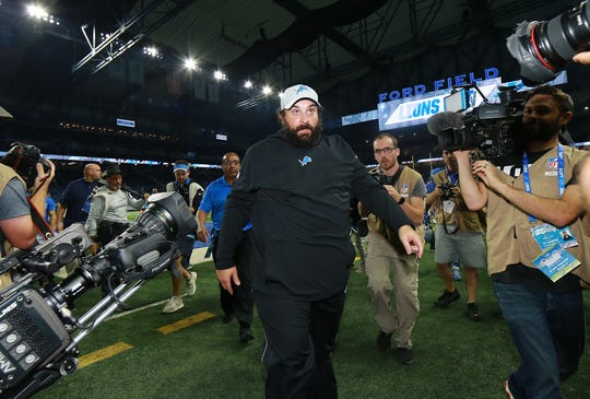 Matt Patricia walks off the field after defeating the Patriots, 26-10, at Ford Field on Sept. 23.