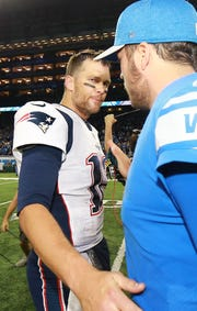 Tom Brady greets Matthew Stafford after the Lions won 26-10 at Ford Field on Sept. 23.