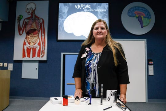Cheryl Phillps, coordinator for St. Joseph Mercy Health Exploration Station shows a display of popular vaping products that she uses for her presentation on the health concerns of vaping.