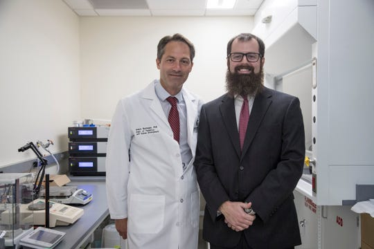 Michigan State University professor Andre S. Bachmann, left, and Helen DeVos Children's Hospital Dr. Caleb Bupp, pose for a photo in MSU Grand Rapids Research Center in Grand Rapids, Wednesday, September 19, 2018.