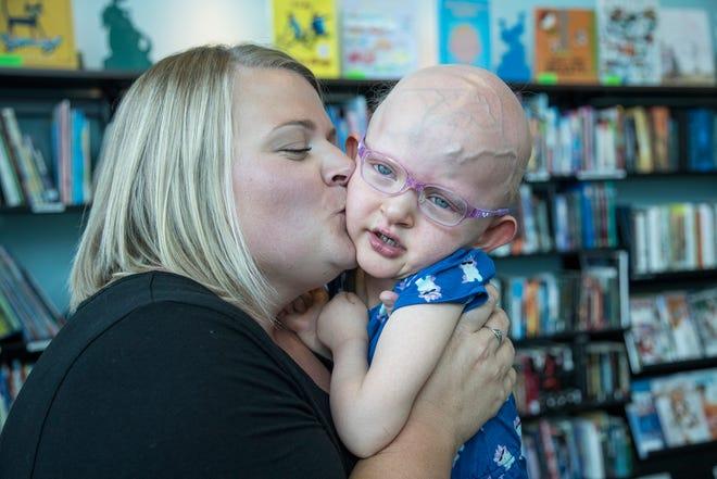 Kelly Berthoud of Mattawan kisses her daughter Marlene, 3, at Helen DeVos Children's Hospital in Grand Rapids, Wednesday, September 19, 2018.