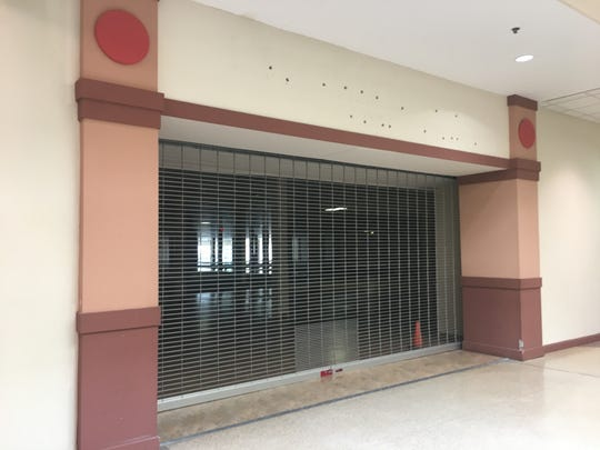 An empty storefront in Eastland Center mall.