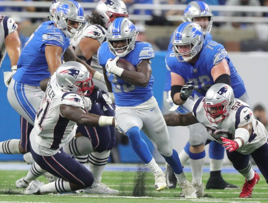 Detroit Lions running back Kerryon Johnson runs the ball against the New England Patriots during the second half Sunday, Sept. 23, 2018 at Ford Field.