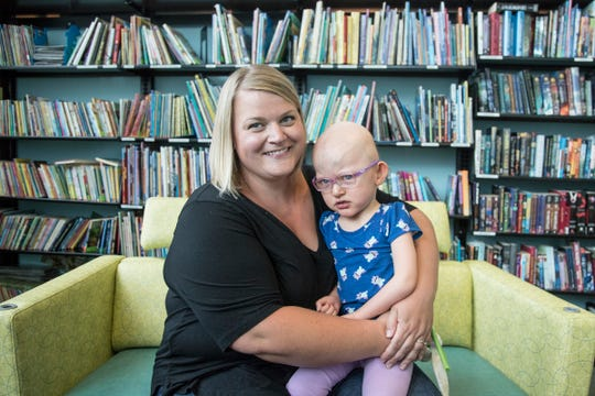 Kelly Berthoud of Mattawan, and her daughter Marlene, 3, pose for a photo at Helen DeVos Children's Hospital in Grand Rapids, Wednesday, September 19, 2018.