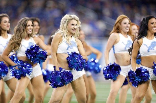 Detroit Lions cheerleaders perform before the game against the New England Patriots at Ford Field on Sept. 23, 2018.
