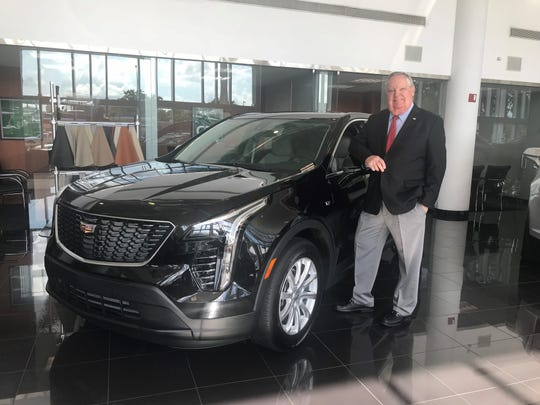Dealer Ed Williamson with one of the new 2019 Cadillac XT4 at his store Willamson Cadillac Co., Miami, Fla.