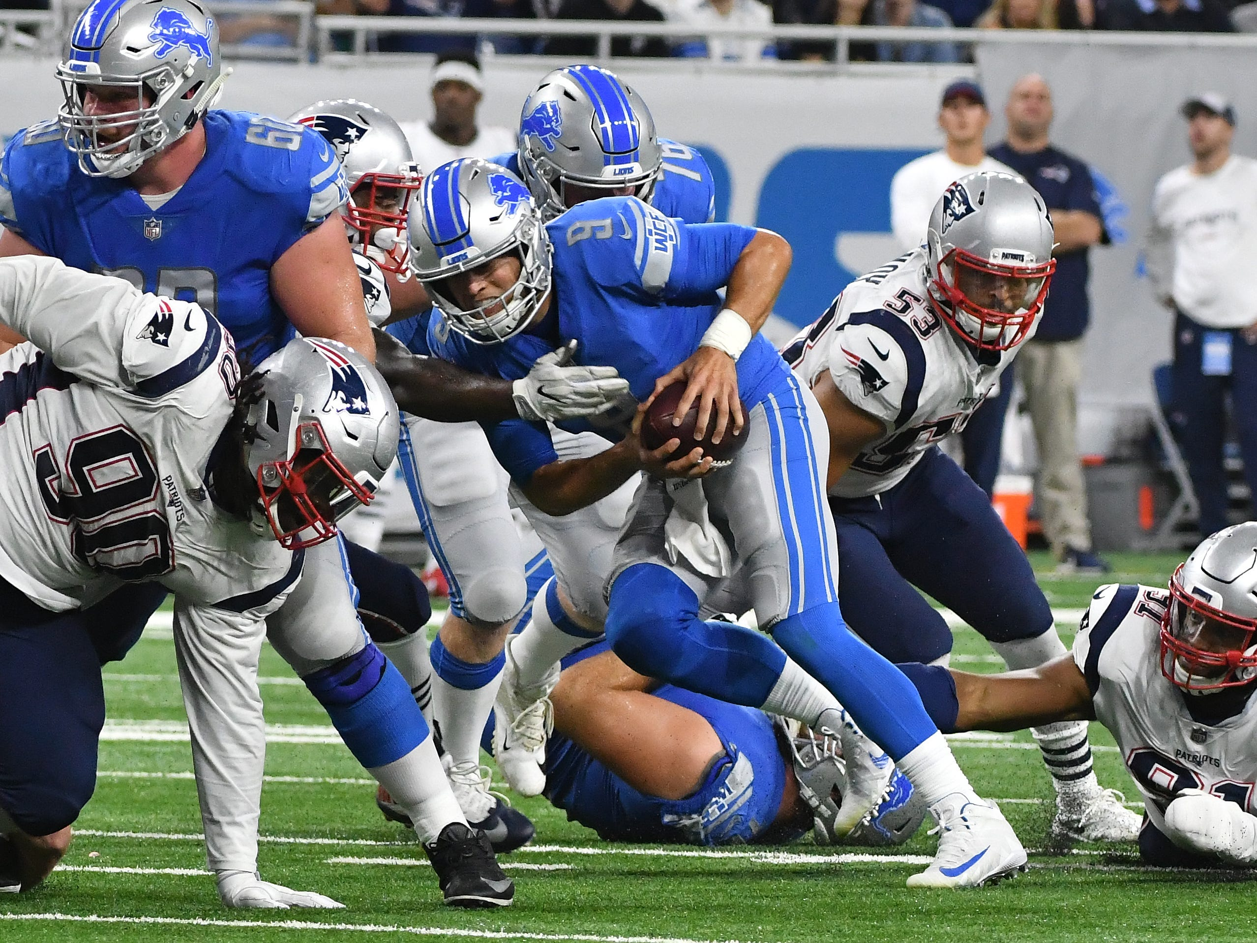 Lions quarterback Matthew Stafford scrambles out of pressure and throws a completion in the second quarter.