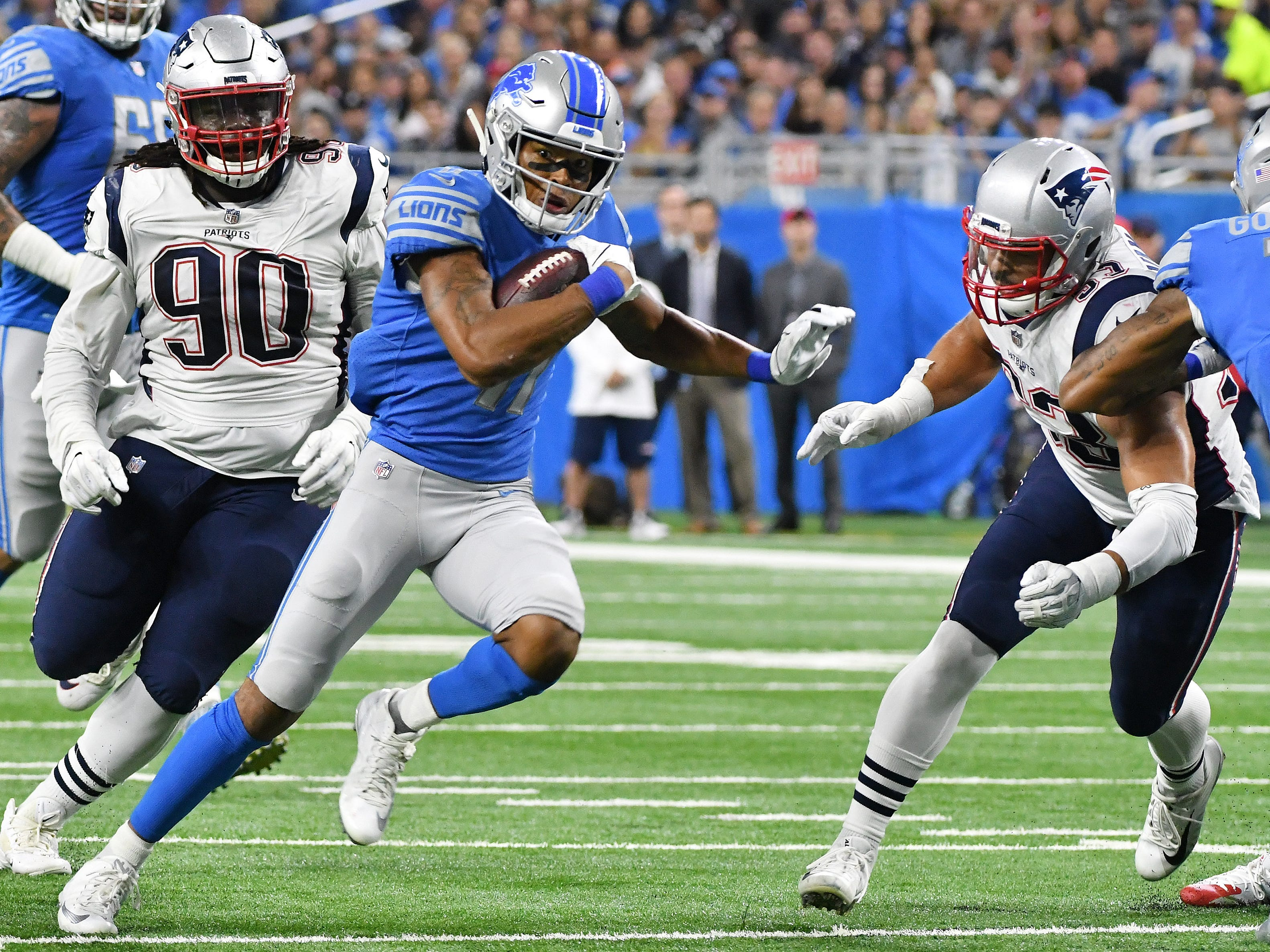 Patriots' Kyle Van Noy, right, comes in for an attempted tackle on Lions' Marvin Jones, Jr. running for a first down in the first half.