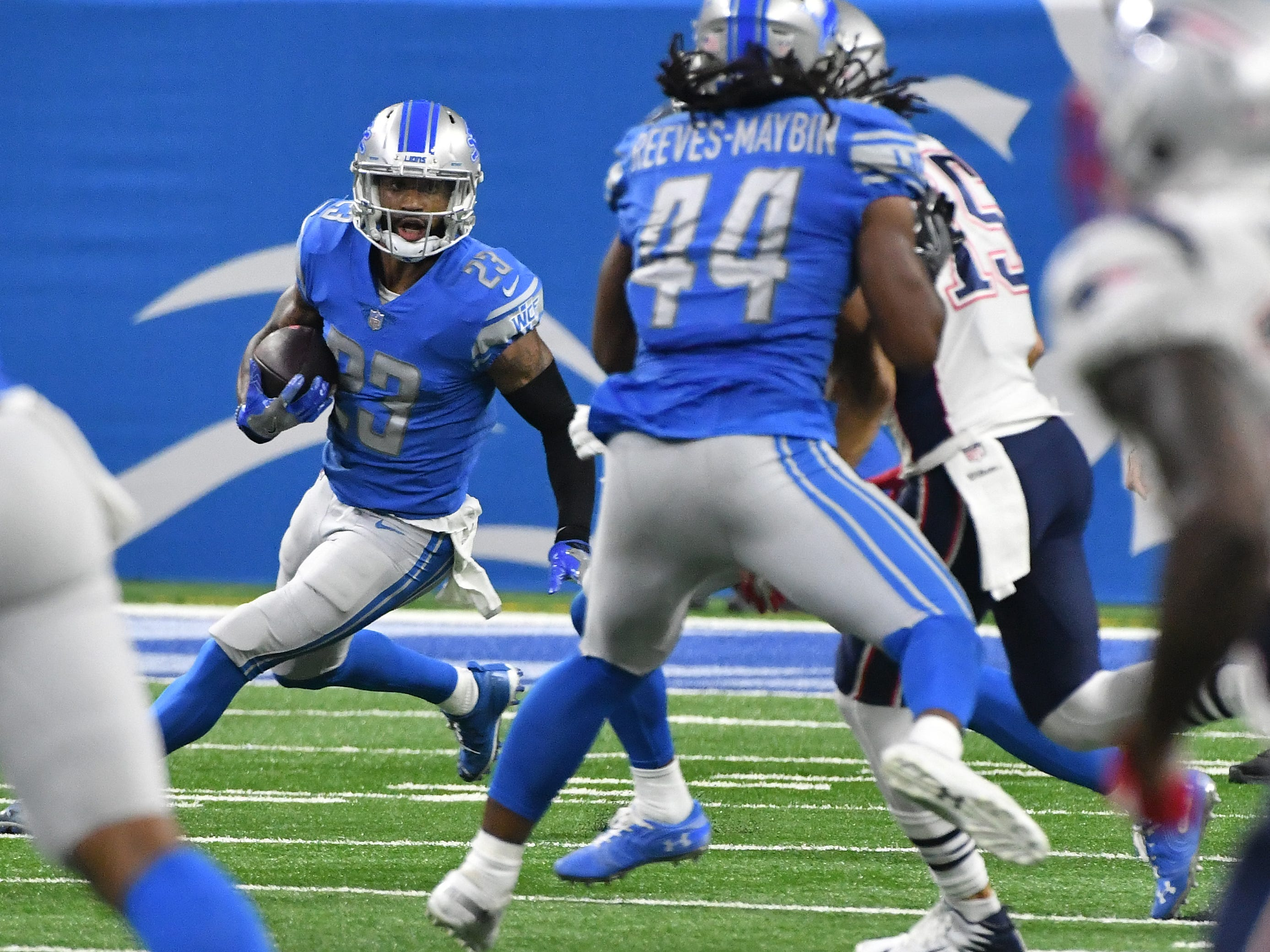 Lions corner back Darius Slay looks for running room after intercepting Patriots' Tom Brady pass in the 4th quarter.