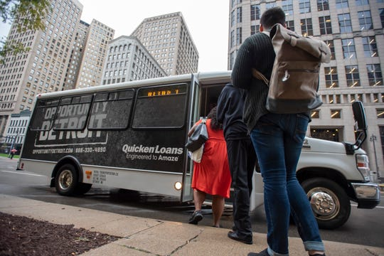 Customers board a Quicken Loans commuter bus on Woodward  near Campus Martius.