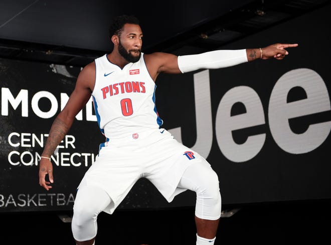 Andre Drummond jokes around with Reggie Jackson during his video shoot for pregame introductions at media day.