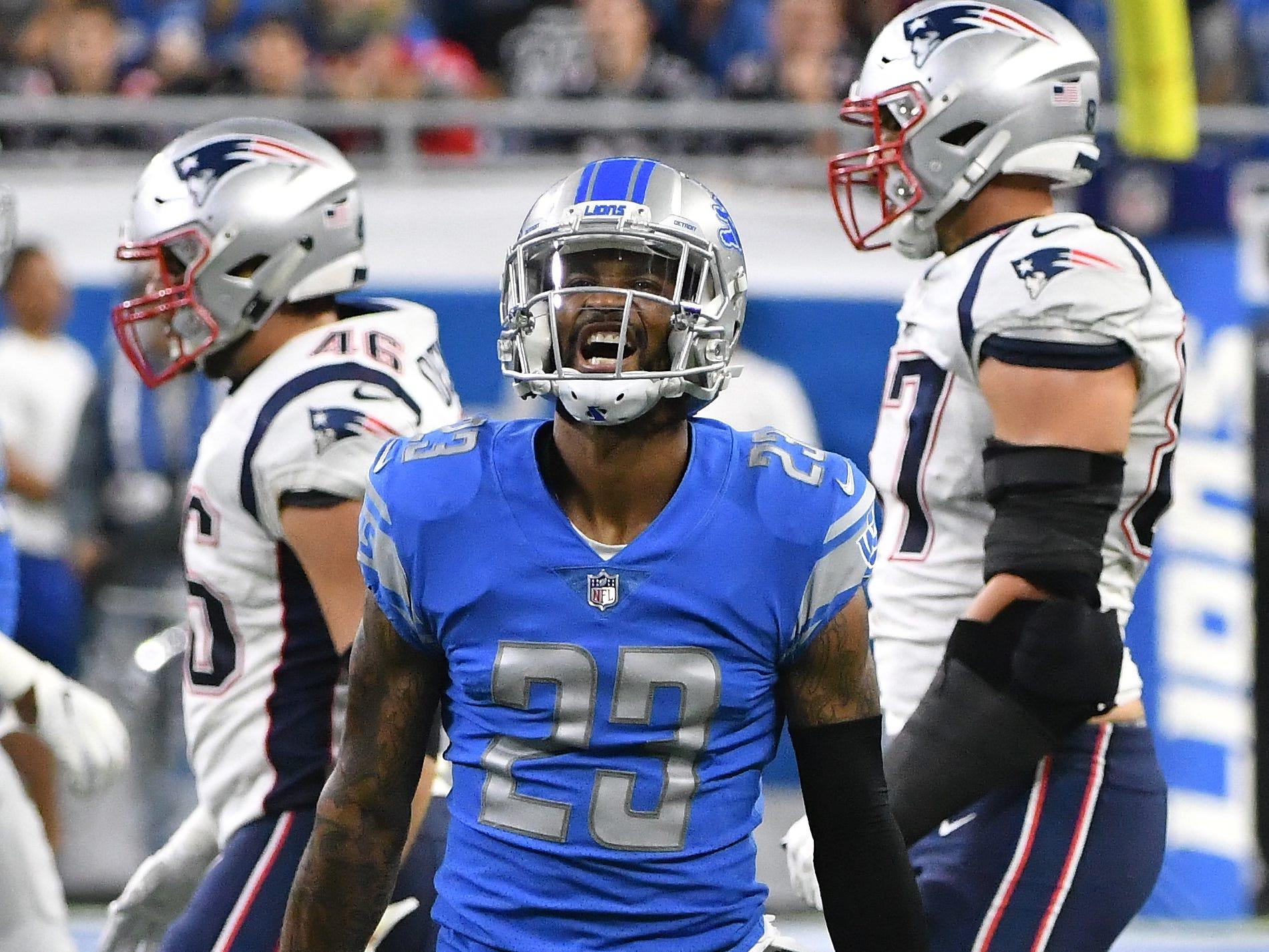 Lions cornerback Darius Slay celebrates after intercepting a Patriots quarterback Tom Brady pass in the 4th quarter.