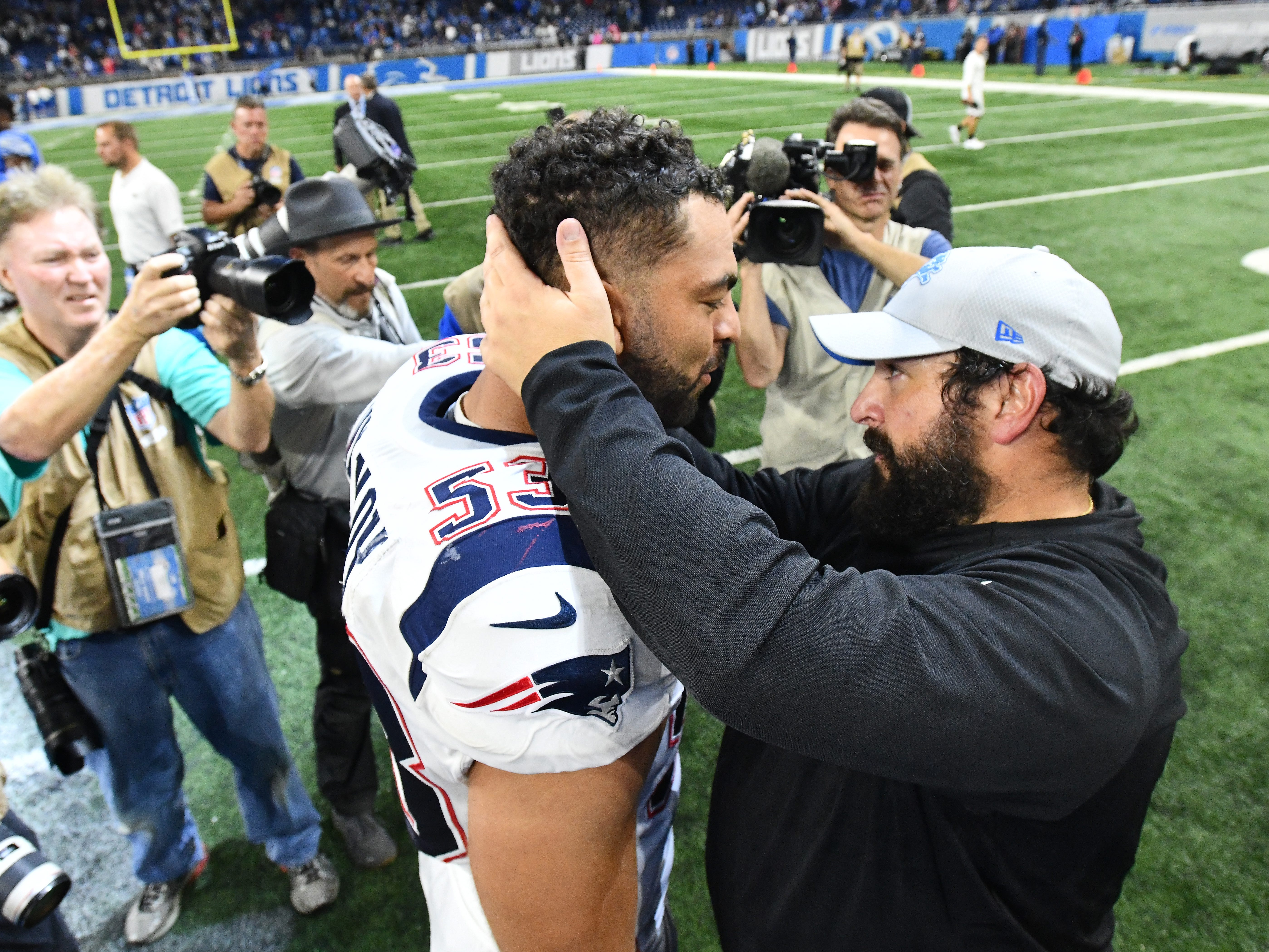 Former Detroit Lions Kyle Van Noy hugs his former New England Coach, now head coach with the Lions, Matt Patricia after the Detroit victory.