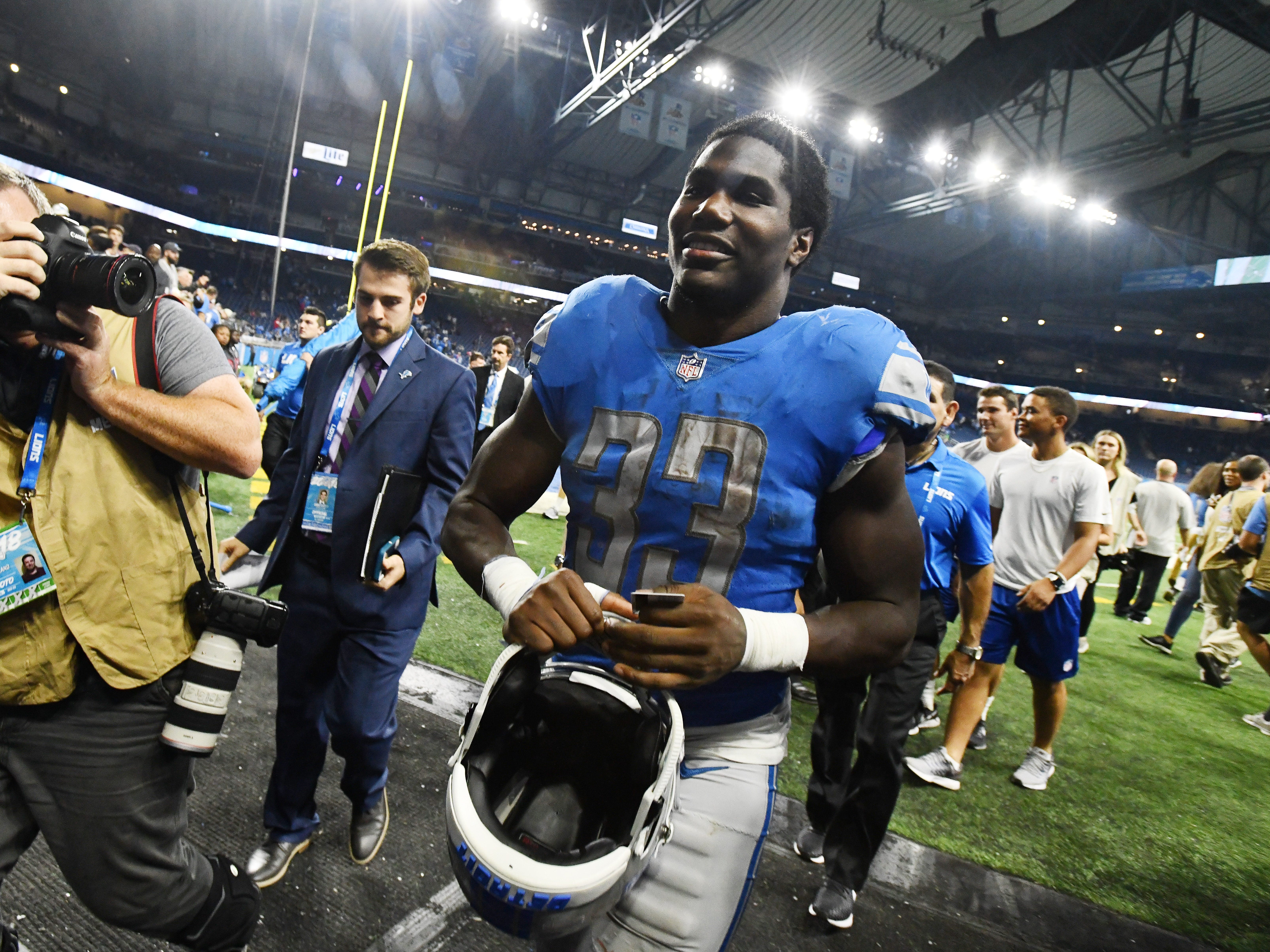 Lions running back Kerryon Johnson, leaving the field, ends Detroit Lions 100-yard rusher drought at 70 games in the 26-10 victory over the Patriots.