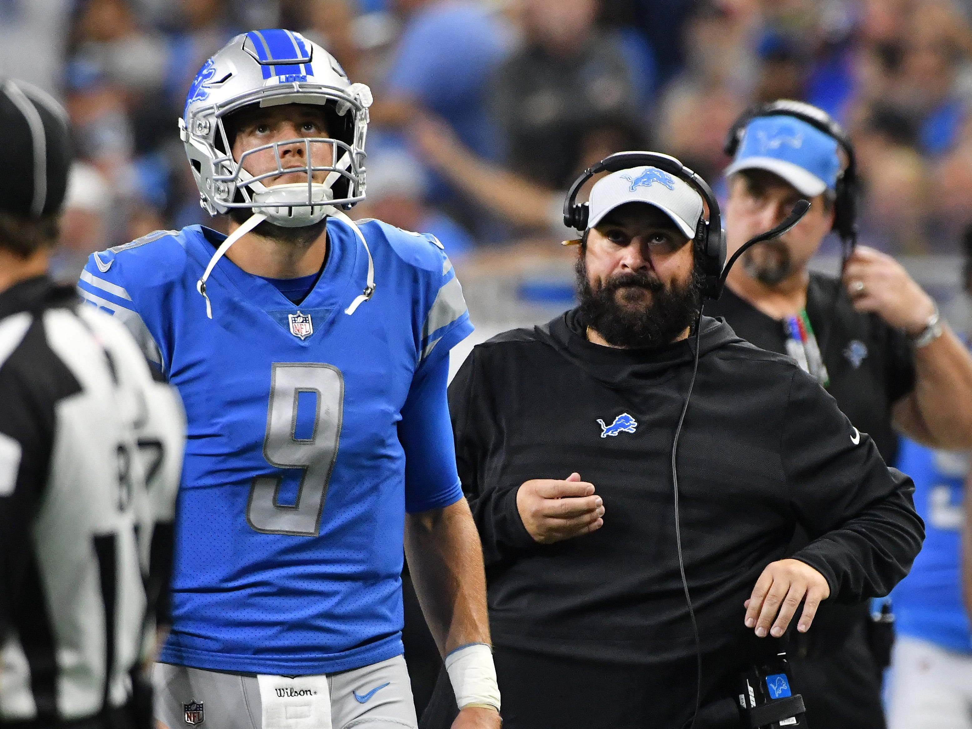 Lions quarterback Matthew Stafford and head coach Matt Patricia watch a replay of the challenged call on a goal line play in the second quarter.