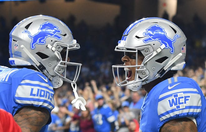 The Lions' Kenny Golladay celebrates with Marvin Jones Jr. after Jones' touchdown reception in the third quarter.