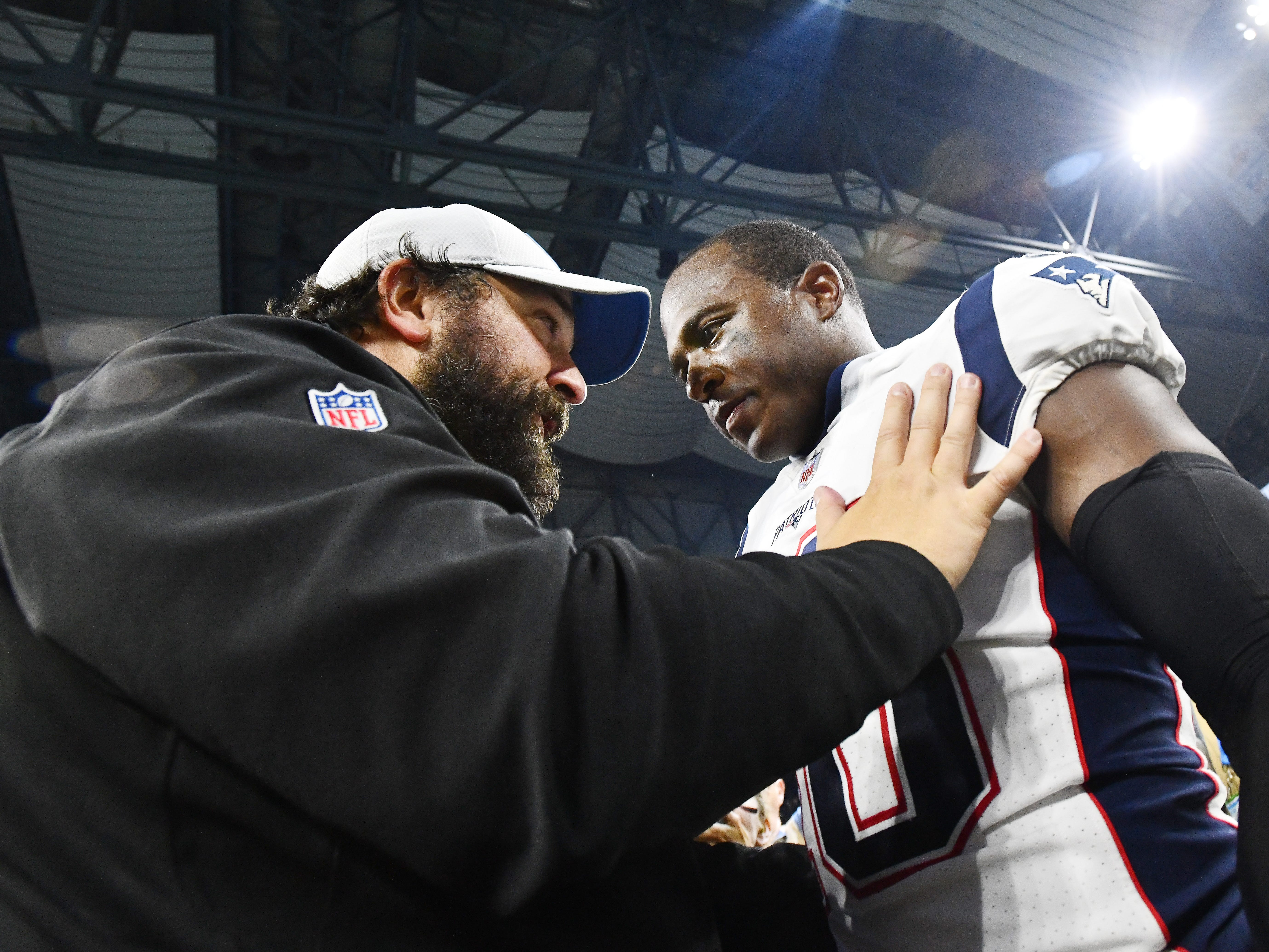 Lions head coach Matt Patricia talks with one of his former players, Patriots' Matthew Slater after the Detroit victory.
