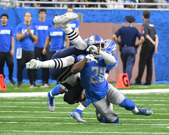 Quandre Diggs and Tavon Wilson brings down the Patriots' Rob Gronkowski earlier this season.