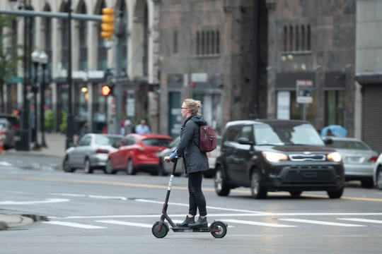 Rented electric scooters recently began darting over downtown sidewalks and streets.