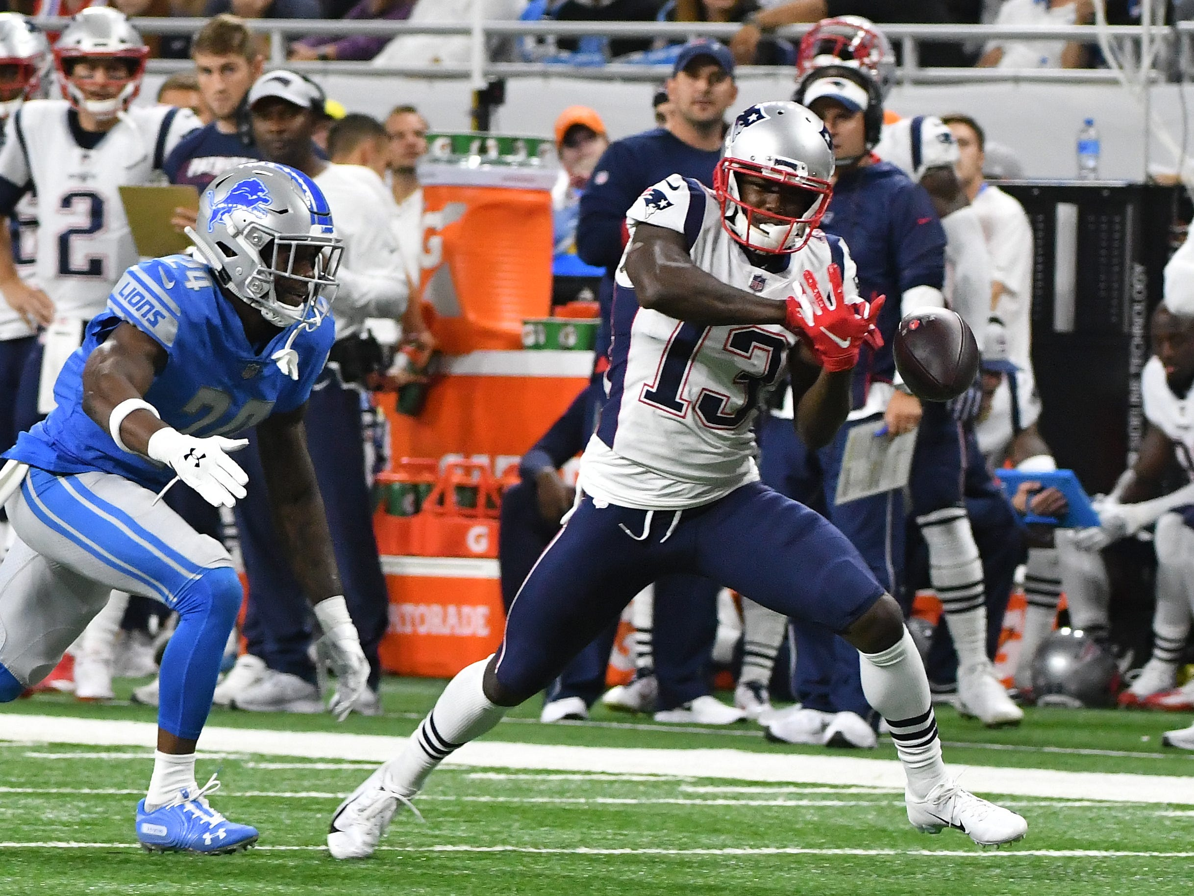 Patriots' Phillip Dorsett can't hang onto a pass that hits his hands with Lions corner back Kevin Lawson defending int he first quarter.