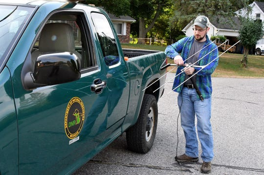 MSU researcher Jonathan Trudeau breaks out a directional antenna to help find some of the deer his group has tagged with GPS trackers.