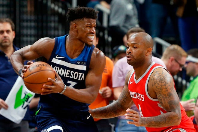 Minnesota Timberwolves star Jimmy Butler, left, most likely won't be suiting up for the Detroit Pistons this season.