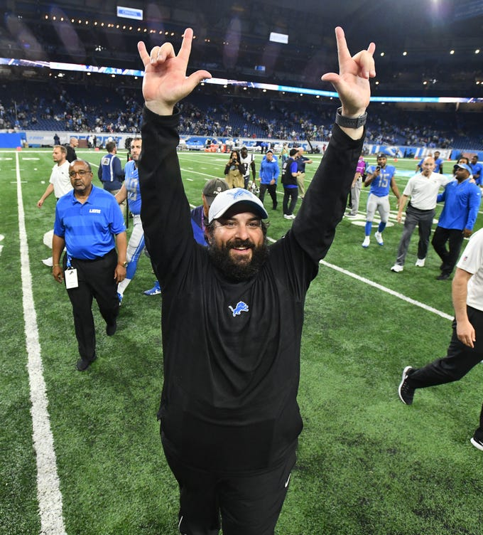 Lions head coach Matt Patricia raises his hands, waving to the stands after the 26-10 victory over his old team, the New England Patriots at Ford Field in Detroit, Michigan on September 23, 2018.