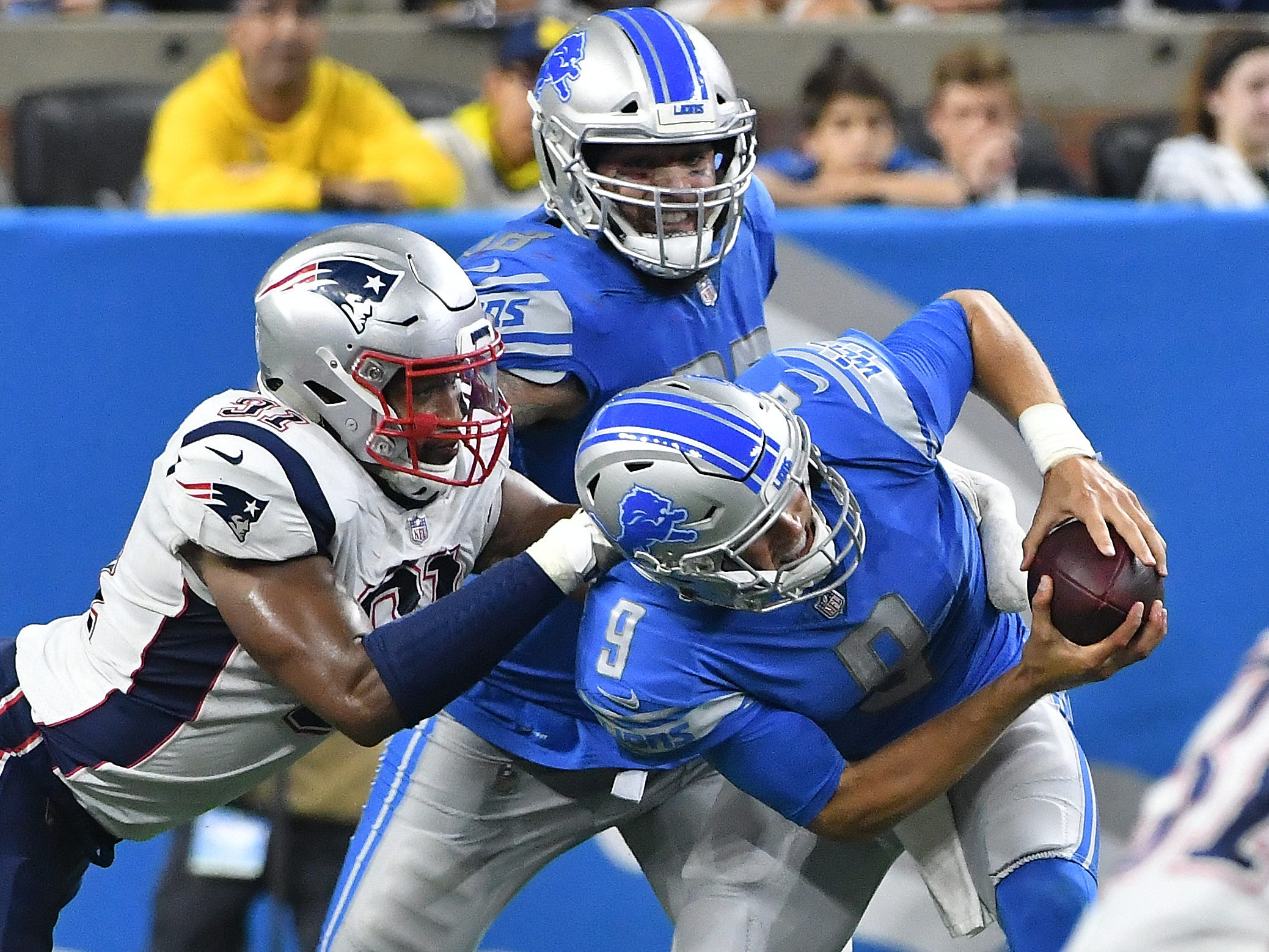 Patriots' Deatrich Wise Jr. gets under Lions offensive lineman Taylor Decker and gets to quarterback Matthew Stafford, getting a sack in the 3rd quarter.