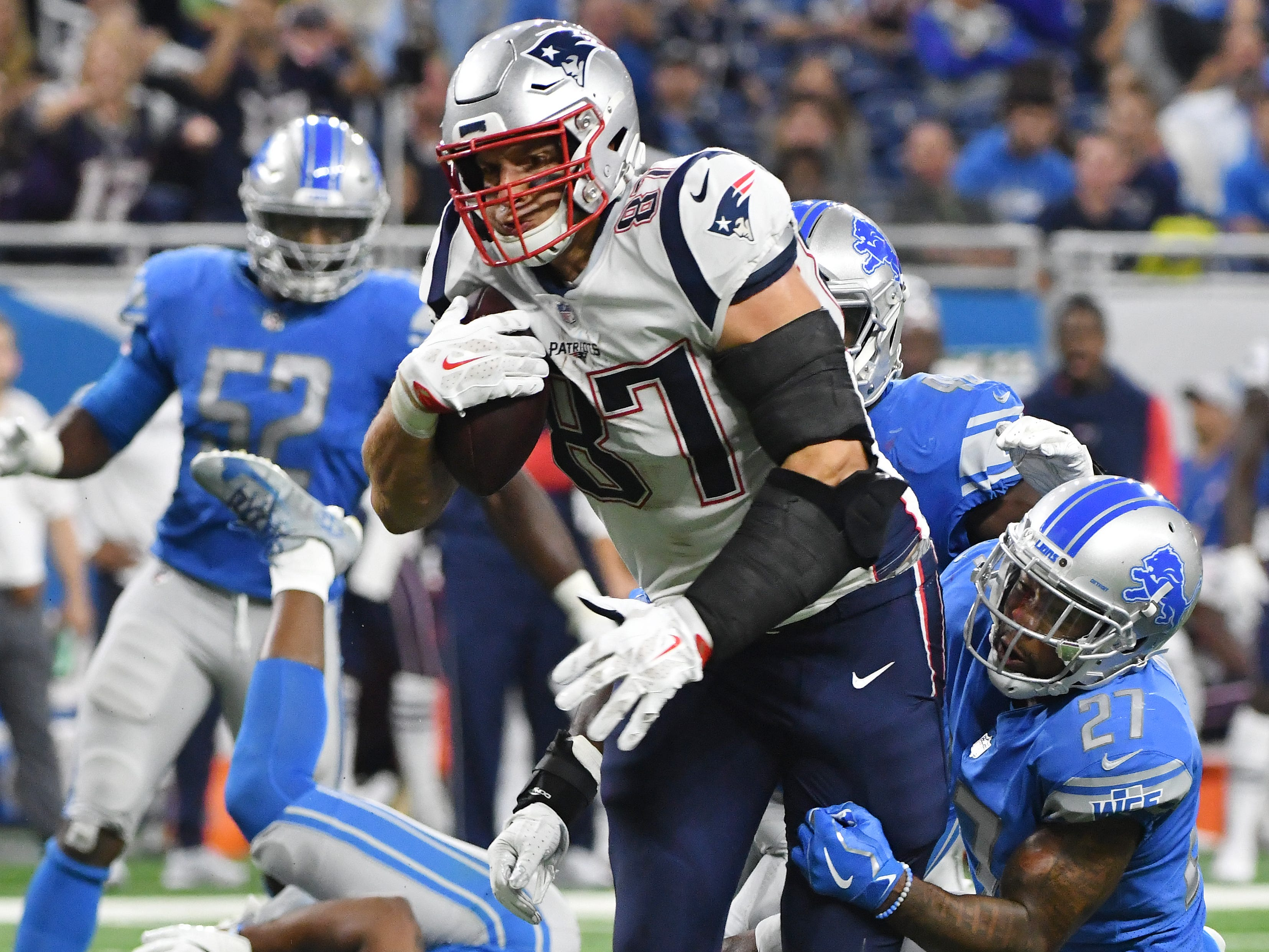 Patriots high end Rob Gronkowski continues upfield after a reception leaving a wake of Lions defensemen in his wake in the 3rd quarter.