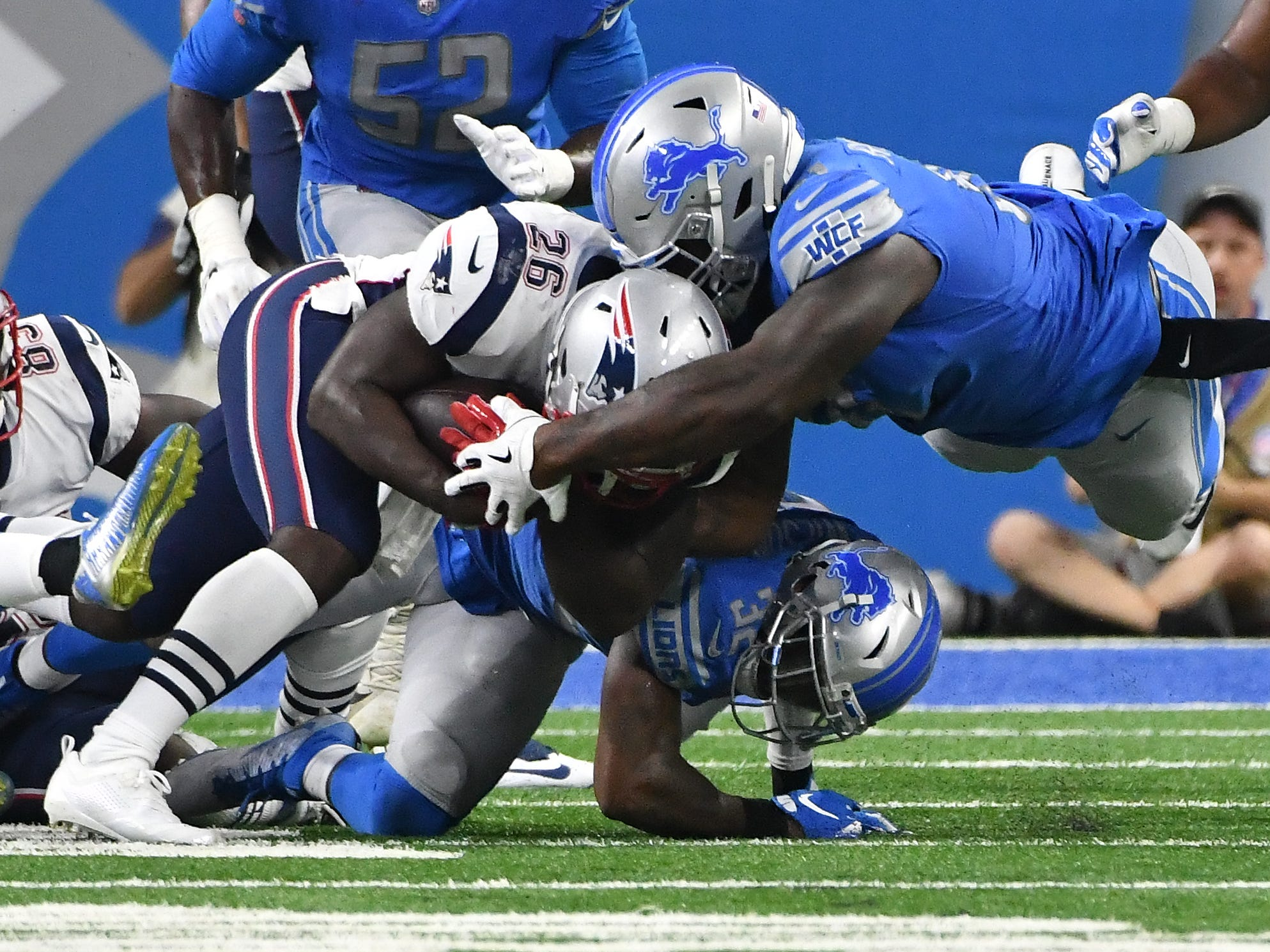 Lions' Tavon Wilson and A'Shawn Robinson stop Patriots' Sony Michel from making a first down on 3rd and one in the second quarter.