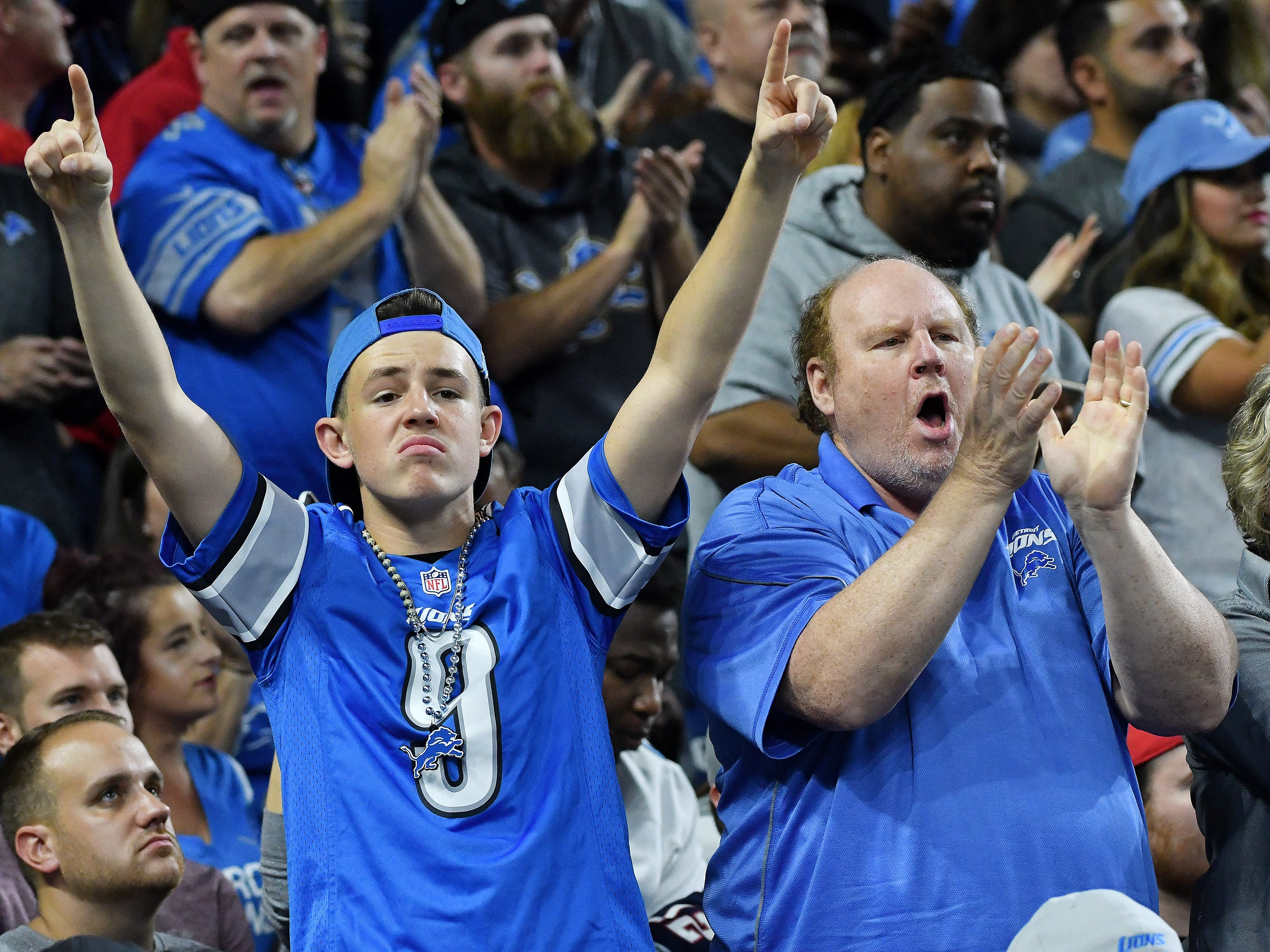 Lions fans cheer after the play in the second quarter is ruled a touchdown after review.