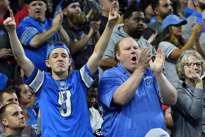 Lions fans cheer during the stunning victory over the Patriots.