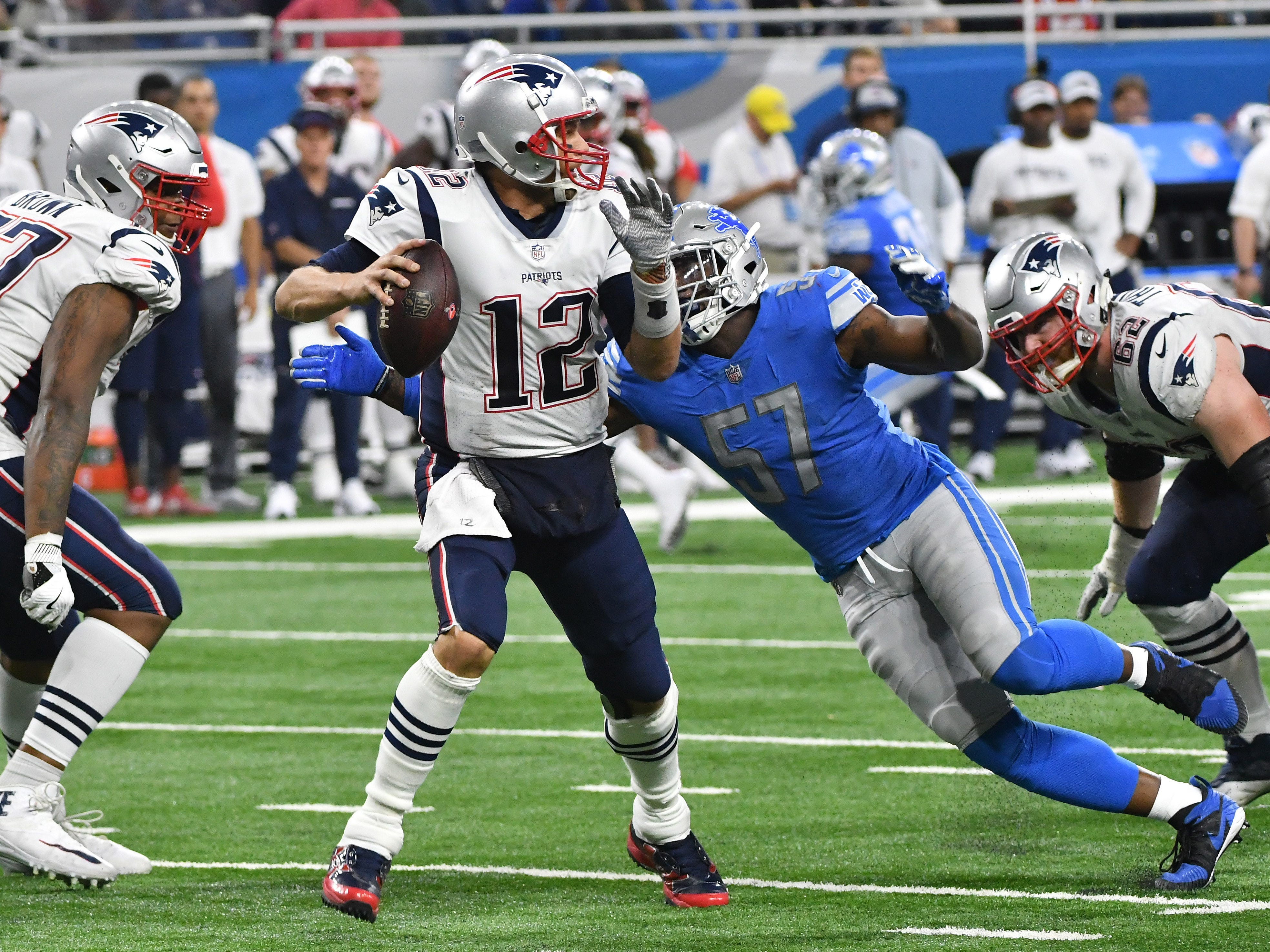 Patriots' Tom Brady is sacked by Lions' Eli Harold in the 4th quarter.