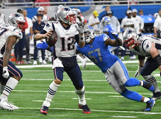 Patriots' Tom Brady is sacked by Lions' Eli Harold in the fourth quarter. Harold had two sacks in Detroit's 26-10 victory.