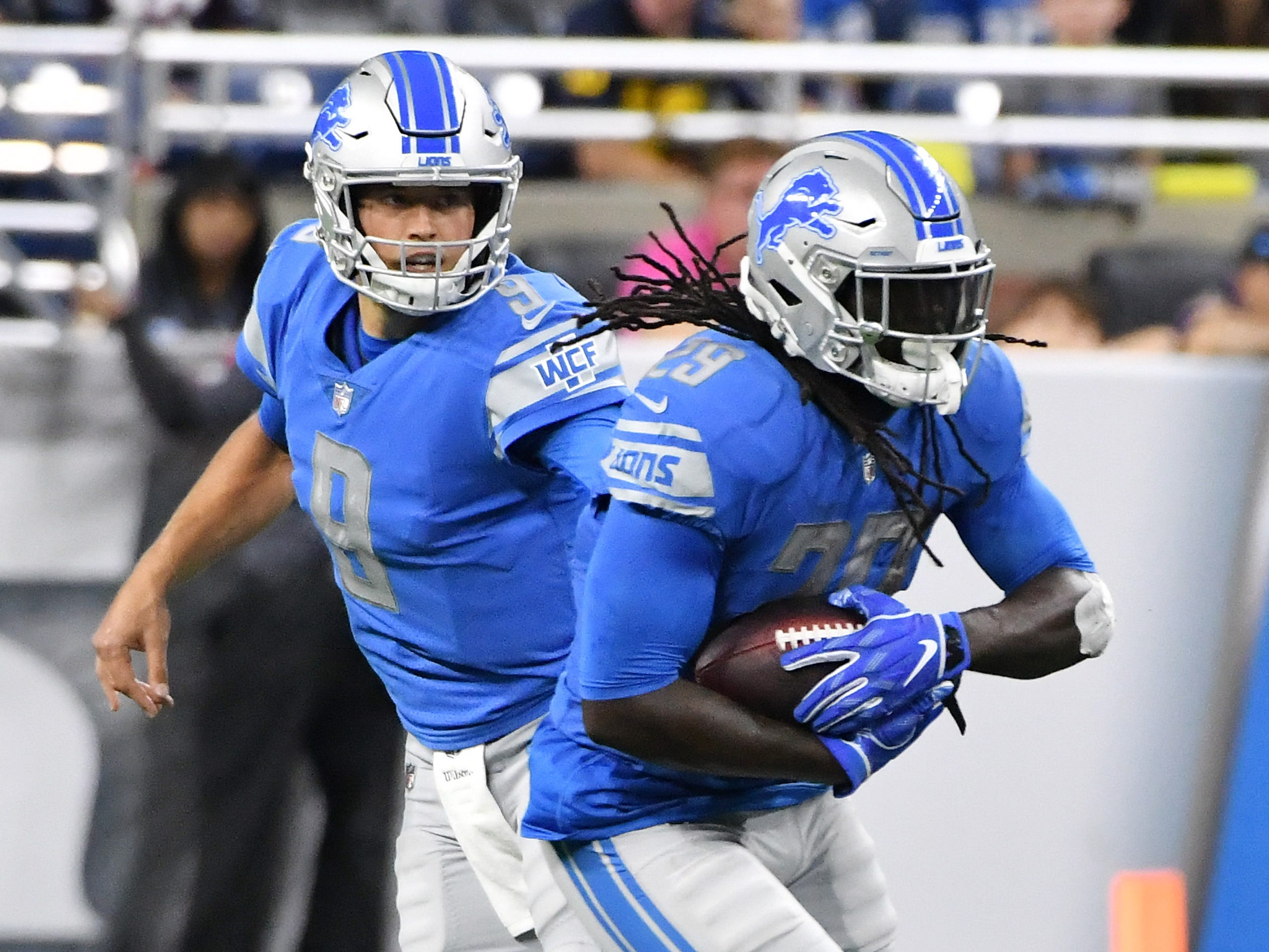 Lions quarterback Matthew Stafford hands off to LeGarrette Blount in the first half.  Detroit Lions vs New England Patriots at Ford Field in Detroit on Sept. 23, 2018.