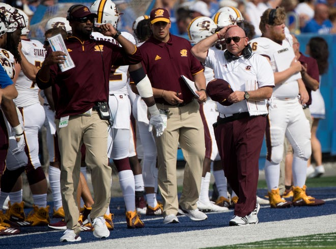 Central Michigan head coach John Bonamego, right, and the Chippewas are 0-3 against FBS competition this season.