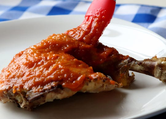 Homemade apple-bourbon barbecue sauce served on chicken.