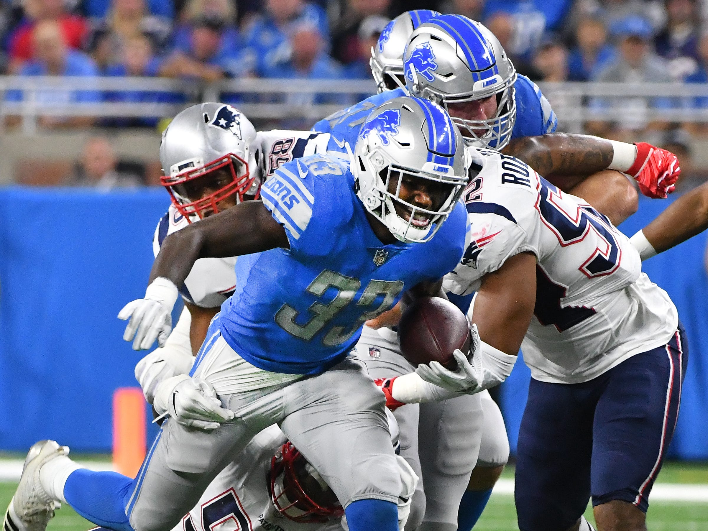 Lions running back Kerryon Johnson breaks up field for a first down run in the first quarter.